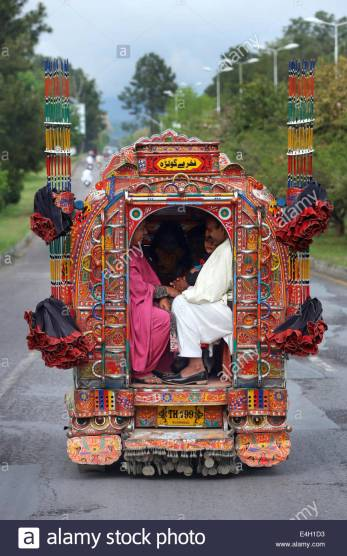 pakistan-islamabad-passengers-in-a-decorated-minibus-public-transport-e4h1d3